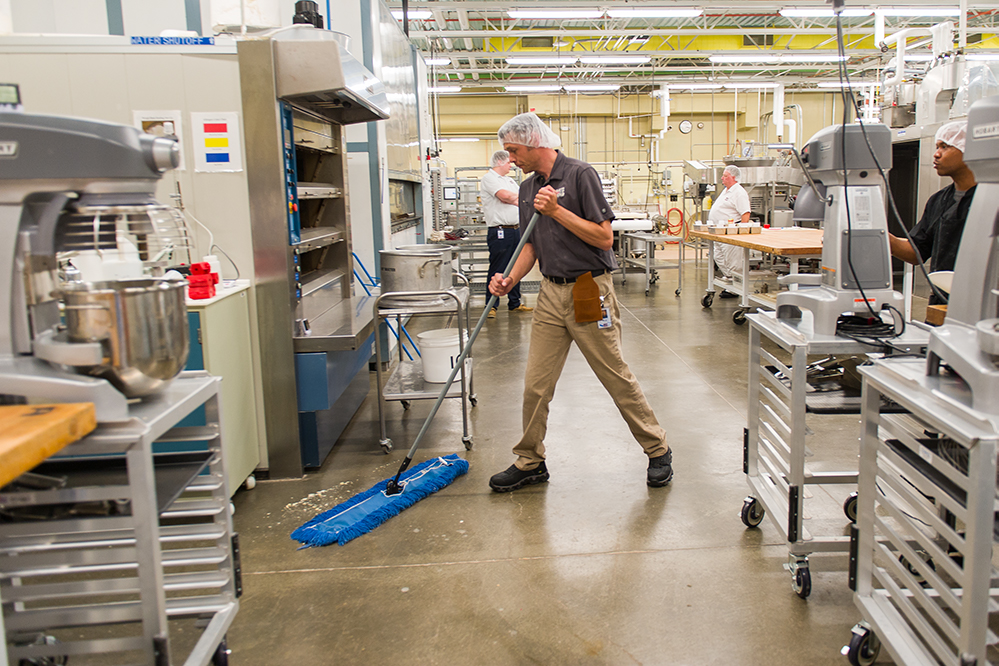 Man sweeping in a food facility