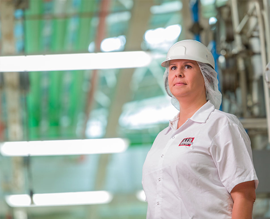 Woman standing in food manufacturing facility